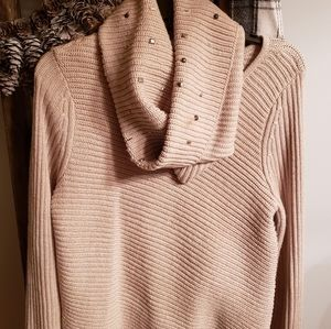 Cream sweater with a removable infinity scarf.